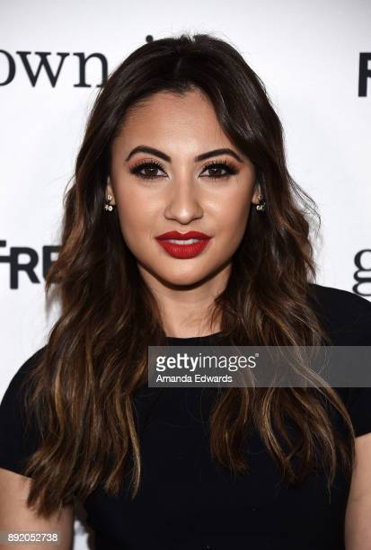 Actress Francia Raisa arrives at the premiere of ABC's 'Grownish' on December 13 2017 in Hollywood California