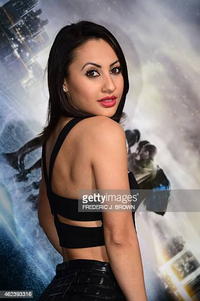 Actress Francia Raisa poses on arrival for the Los Angeles Premiere of Project Almanac on January 27 2015 in Hollywood California The film opens...