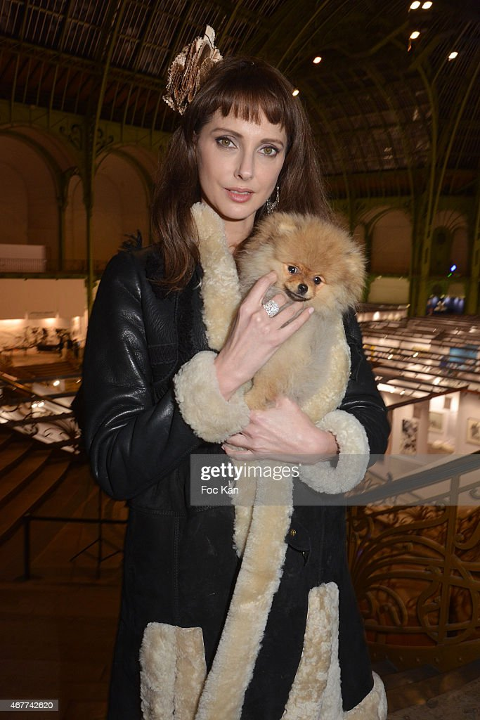 Actress Frederique Bel and 'Joca ze dog' attend the 'Diamond Night by Divinescence Vendome' - Harumi Klossowska Jewellery Exhibition Preview As Part Of Art Paris Art Fair at the Grand Palais on March 26, 2015 in Paris, France.