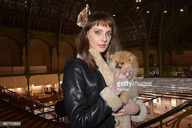 Actress Frederique Bel and 'Joca ze dog' attend the 'Diamond Night by Divinescence Vendome' Harumi Klossowska Jewellery Exhibition Preview As Part Of...