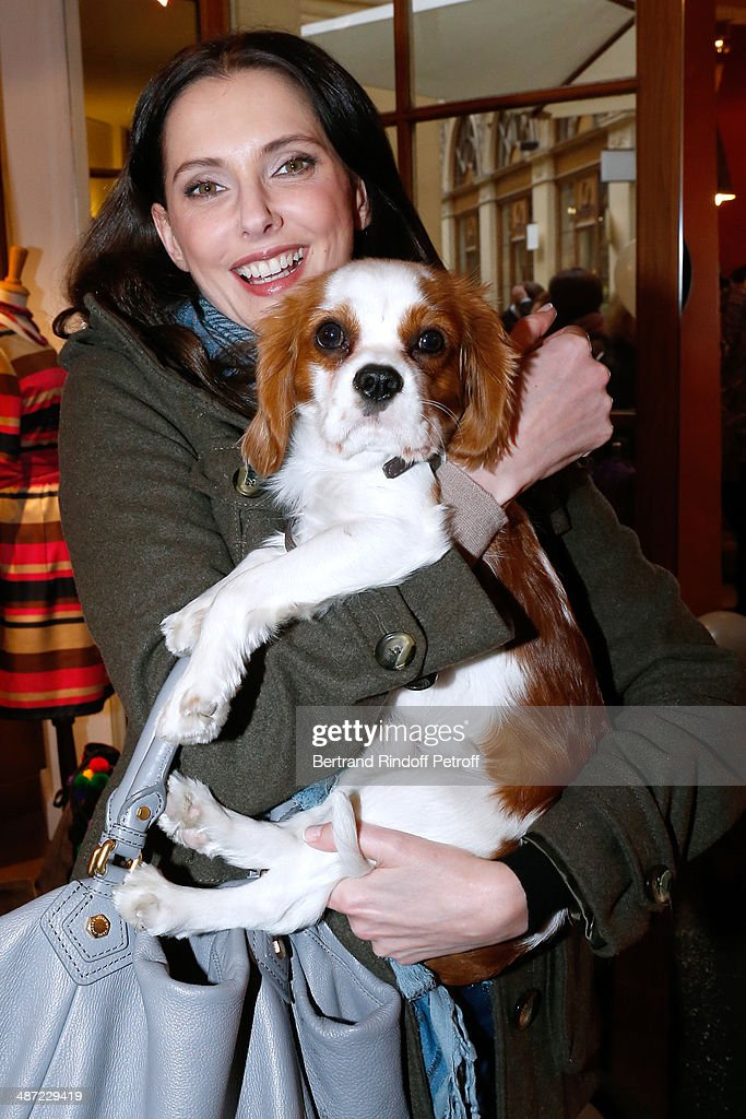 Actress Frederique Bel and the dog of Jean De La Motte-Rouge, Oscar attend the 'Charriol': Ephemeral Boutique opening hosted by Nathalie Garcon at Nathalie Garcon store, Galerie Vivienne on April 28, 2014 in Paris, France.