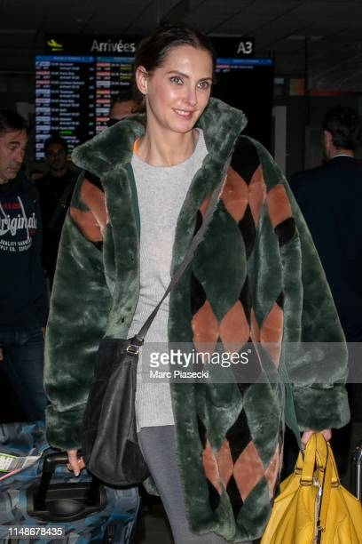 Actress Frederique Bel arrives ahead of the 72nd annual Cannes Film Festival at Nice Airport on May 12, 2019 in Nice, France.
