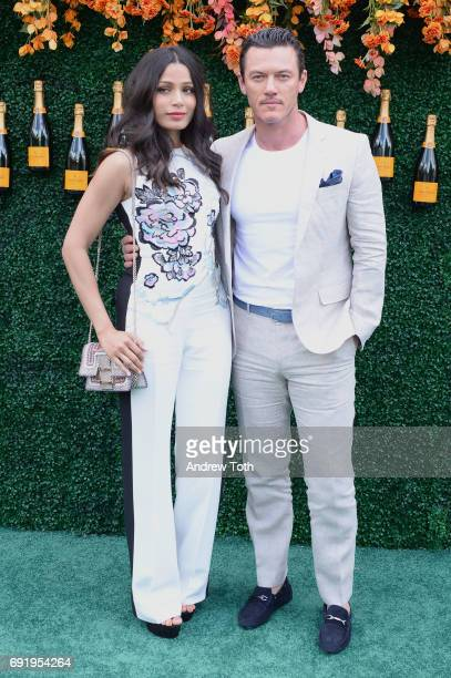 Actress Freida Pinto and actor Luke Evans attend The Tenth Annual Veuve Clicquot Polo Classic at Liberty State Park on June 3 2017 in Jersey City New...