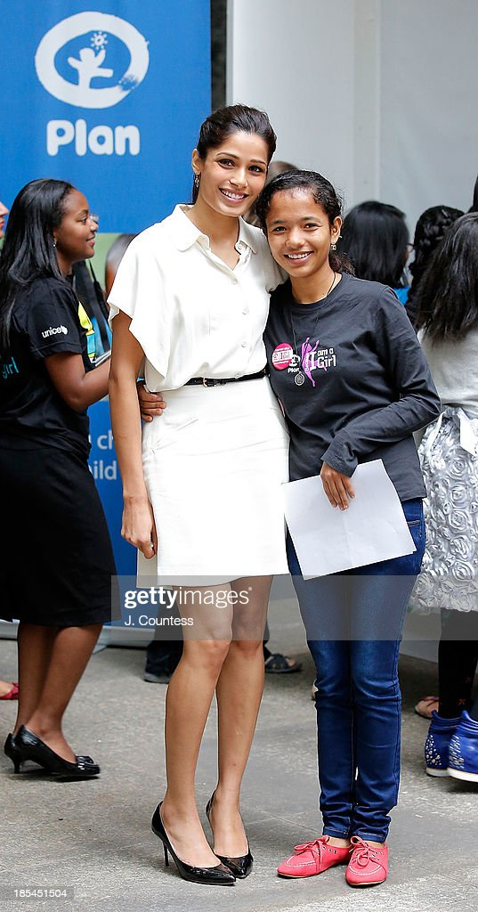 Actress Freida Pinto and 'Because I am a Girl' Youth Ambassador Tulsi Thapa pose for a photo during the 'Day Of The Girl' Fresco Unveiling With Freida Pinto at UNICEF House on October 11, 2013 in New York City.