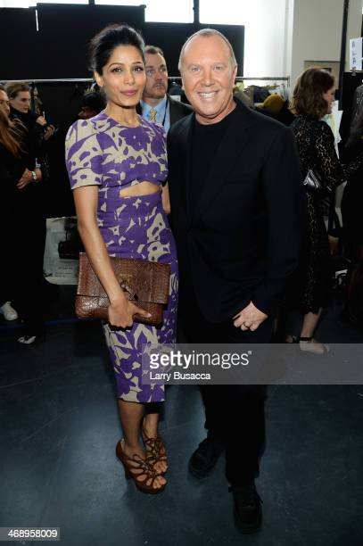 Actress Freida Pinto and designer Michael Kors pose backstage at the Michael Kors fashion show during MercedesBenz Fashion Week Fall 2014 at Spring...