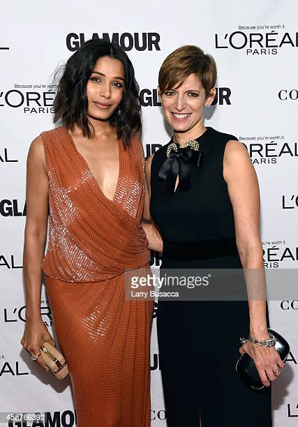 Actress Freida Pinto and editorinchief of Glamour magazine Cindi Leive attend the Glamour 2014 Women Of The Year Awards at Carnegie Hall on November...