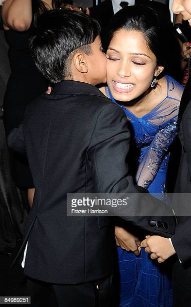 Actress Freida Pinto dances with cast members at the Fox Searchlight Oscar after party for Slumdog Millionaire and The Wrestler held at One Sunset on...