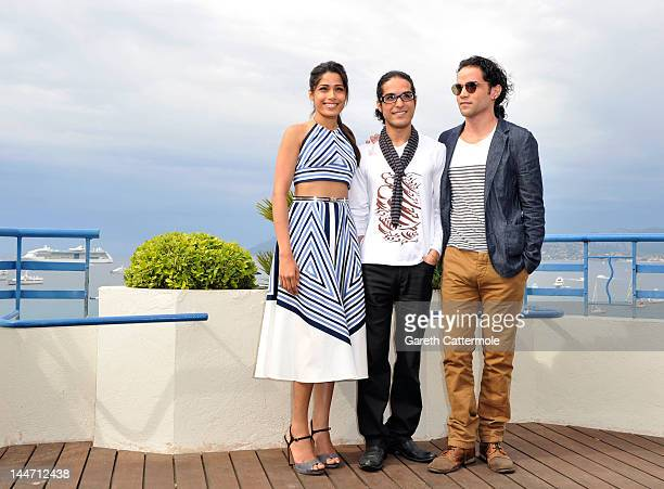 Actress Freida Pinto Director Afshin Ghaffarin and Actor Reece Ritchie pose for a photocall during the 65th Annual Cannes Film Festival on May 18...