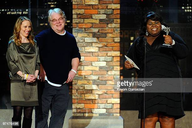 Actress Gabourey Sidibe accepts Best Female Lead for Precious from presenters Amy Ryan and Philip Seymour Hoffman onstage during the 25th Film...