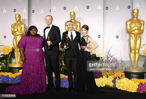 Actress Gabourey Sidibe editor Mark Sanger director Alfonso Cuaron winners of Best Achievement in Editing and actress Anna Kendrick pose in the press...