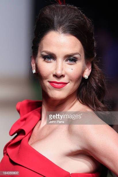 Actress Gabriela Vergara walks the runway during Red Dress Fashion Show at Funkshion to benefit Go Red For Women on October 12 2012 in Miami Beach...