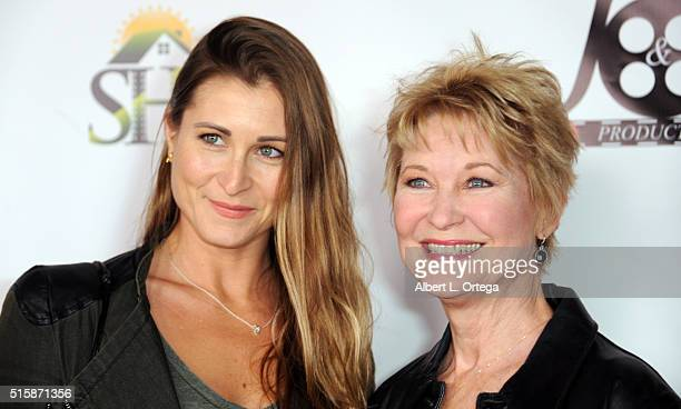 Actress Gabrielle Stone and mother/actress Dee Wallace arrive for the Premiere Of JR Productions' Halloweed held at TCL Chinese 6 Theatres on March...