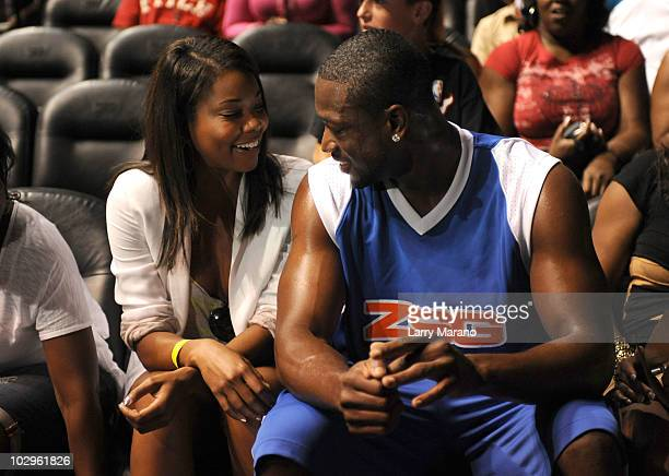 Actress Gabrielle Union and Basketball Player Dwyane Wade attend Summer Groove AllStar Basketball Game at AmericanAirlines Arena on July 18 2010 in...