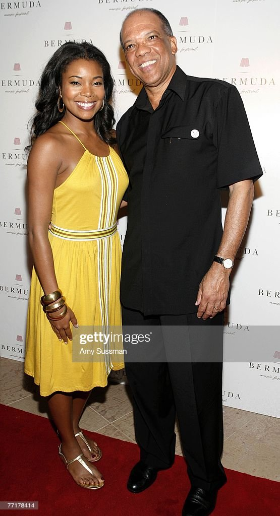 Actress Gabrielle Union (L) and Dr. Ewart F. Brown, JP, MP, Bermuda Premier and Minister of Tourism and Transport (R) attends the first night of the Bermuda Music Festival at Southampton Beach Club on October 3, 2007 in Southampton, Bermuda.