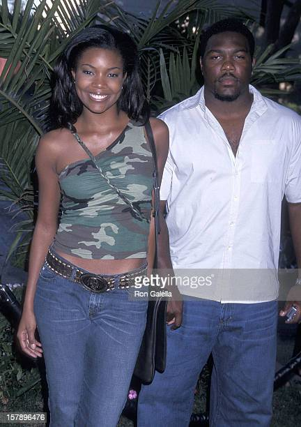 Actress Gabrielle Union and husband athlete Chris Howard attend the American Eagle Outfitters Showroom Grand Opening Celebration on June 27 2001 at...