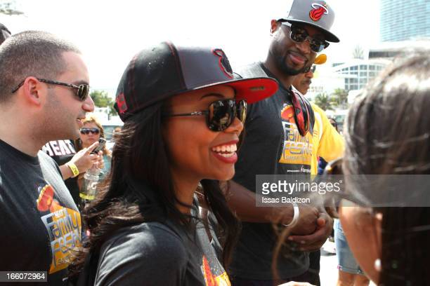 Actress Gabrielle Union and LeBron James of the Miami Heat enjoy the Miami Heat Family Festival on April 7 2012 at American Airlines Arena in Miami...