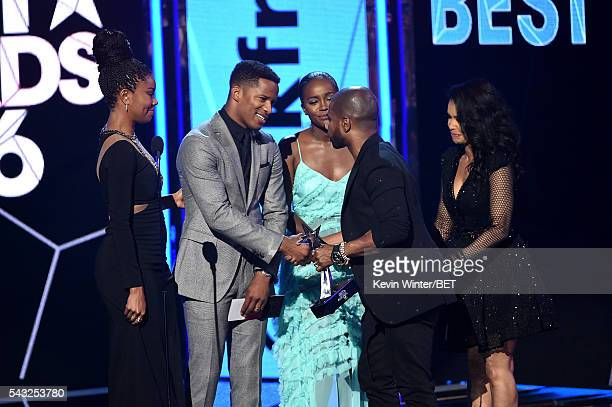 Actress Gabrielle Union director/actor Nate Parker and actress Aja Naomi King present the Best Gospel/Inspirational award to recording artist Kirk...