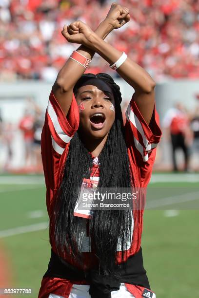 Actress Gabrielle Union greets fans during a break in the game between the Nebraska Cornhuskers and the Rutgers Scarlet Knights at Memorial Stadium...