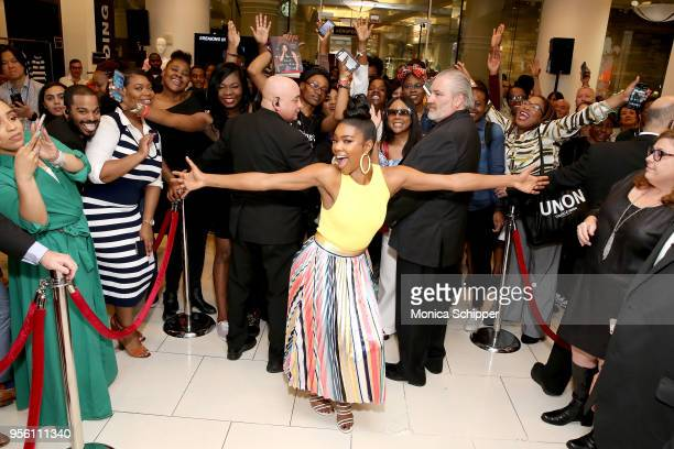 Actress Gabrielle Union poses with fans at the New York Company x Breaking In Partnership on May 8 2018 in New York City