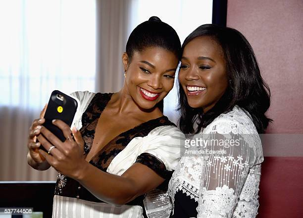 Actress Gabrielle Union takes a selfie with actress Aja Naomi King at Master Class with Nate Parker during the 2016 Los Angeles Film Festival at...