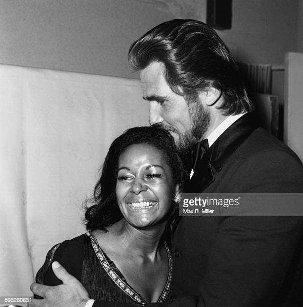 Actress Gail Fisher being kissed on the head by actor James Brolin at the Golden Globe Awards Los Angeles February 1971