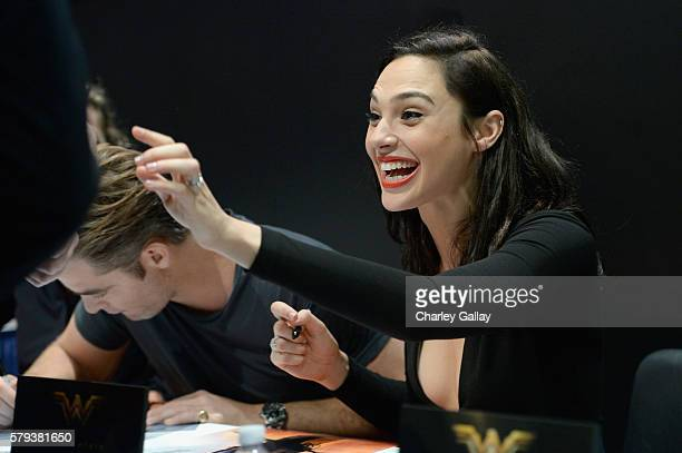 Actress Gal Gadot from the 2017 feature film Wonder Woman signs autographs for fans in DC's 2016 San Diego Comic-Con booth at San Diego Convention...