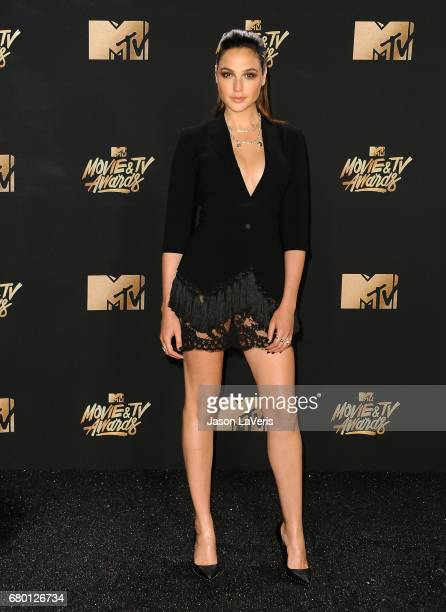 Actress Gal Gadot poses in the press room at the 2017 MTV Movie and TV Awards at The Shrine Auditorium on May 7 2017 in Los Angeles California