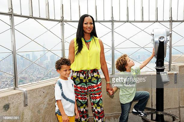 Actress Garcelle Beauvais and children Jaid Thomas Nilon Jax Joseph Nilon visit The Empire State Building on June 3 2013 in New York City