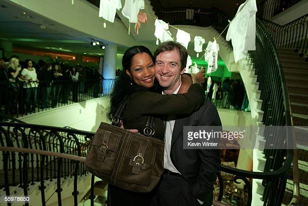 Actress Garcelle Beauvais and her husband Mike Nilon attend the LACOSTE and Barneys New York unveiling of celebrity customized polos held at Barney's...