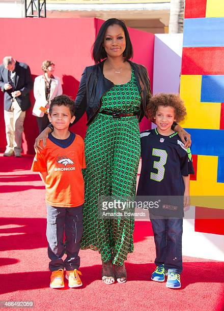 Actress Garcelle Beauvais and her sons arrive at the Los Angeles premiere of The Lego Movie at the Regency Village Theatre on February 1 2014 in...