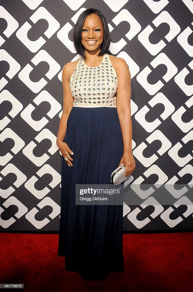 Actress Garcelle Beauvais arrives at Diane Von Furstenberg's 'Journey Of A Dress' premiere opening party at Wilshire May Company Building on January 10, 2014 in Los Angeles, California.