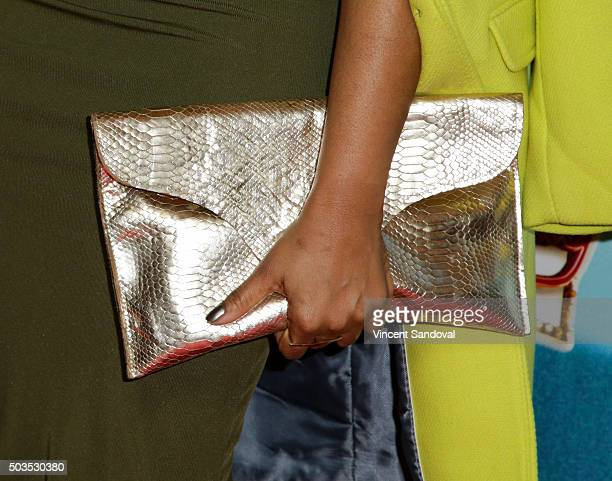 """Actress Garcelle Beauvais, purse detail, attends the red carpet premiere of """"Bullets Over Broadway"""" at the Pantages Theatre on January 5, 2016 in..."""
