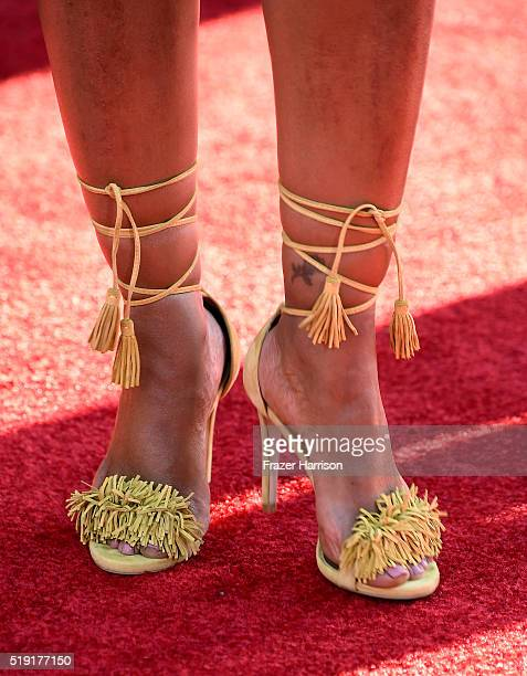 Actress Garcelle Beauvais shoe detail attends the premiere of Disney's The Jungle Book at the El Capitan Theatre on April 4 2016 in Hollywood...