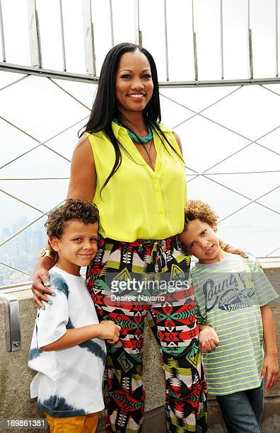 Actress Garcelle Beauvais with children Jaid Thomas Nilon and Jax Joseph Nilon visit The Empire State Building on June 3 2013 in New York City