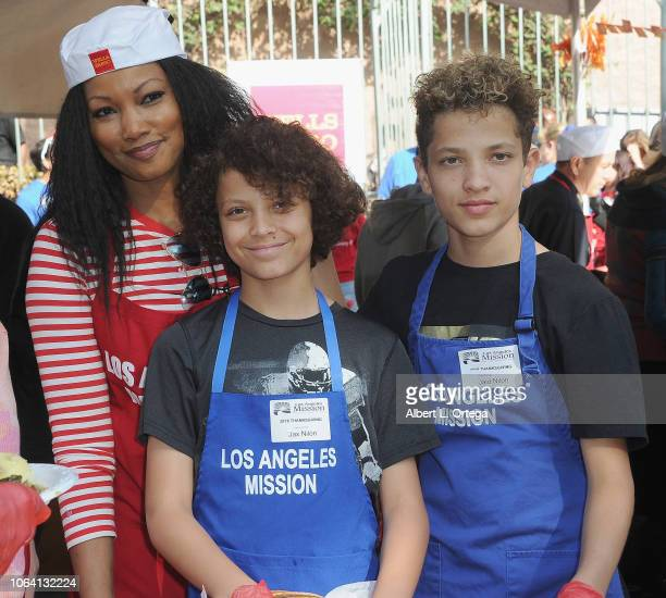 Actress Garcelle Beauvais wth sons Jaid Thomas Nilon and Jax Joseph Nilon attend the Los Angeles Mission hosts a Thanksgiving event for the homeless...