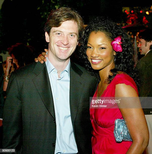 Actress Garcelle BeauvaisNilon and her husband Mike Nilon pose at the afterparty for Paramount's The Stepford Wives at the Armand Hammer Museum on...