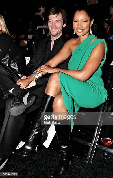 Actress Garcelle Beauvais-Nilon and husband Mike Nilon pose in the front row at the Kevan Hall Spring 2006 show during Mercedes-Benz Fashion Week at...