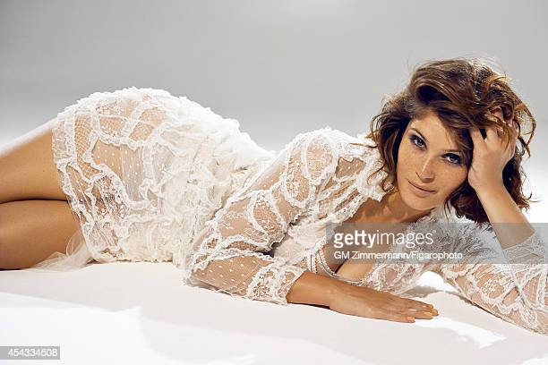 Actress Gemma Arterton is photographed for Madame Figaro on June 19, 2014 in Paris, France. Dress , bodysuit , earrings . Make-up by Sisley....