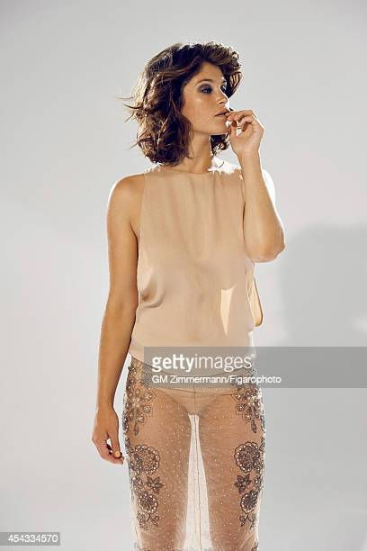 110258006 Actress Gemma Arterton is photographed for Madame Figaro on June 19 2014 in Paris France Top skirt and underwear Makeup by Sisley PUBLISHED...