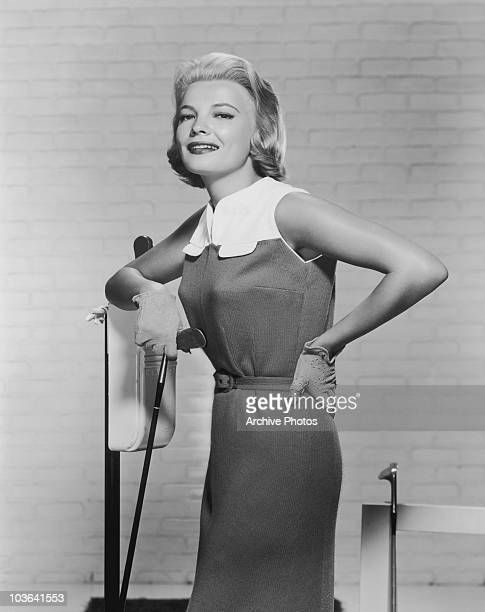 Actress Gena Rowlands pictured holding a golf club USA circa 1958 Rowlands is wearing a knitjersey yoked with white kidskin and golfing gloves