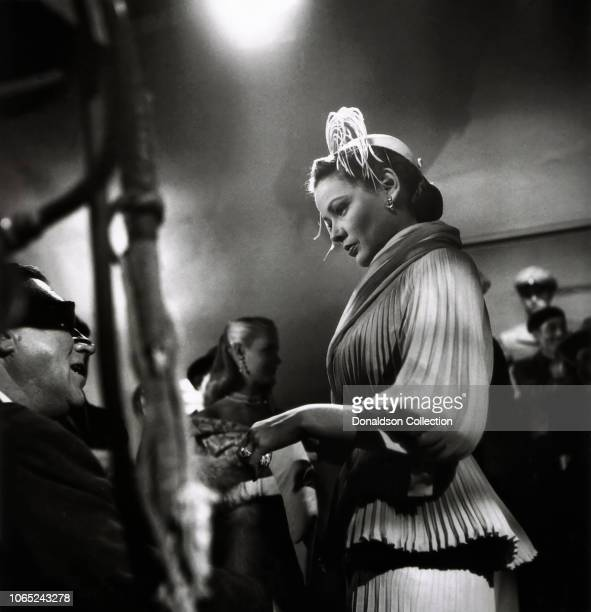 Actress Gene Tierney a director Walter Lang in a scene from the movie On the Riviera