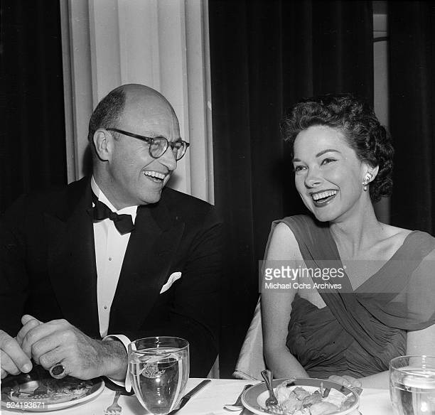 Actress Gene Tierney and escort attend the Humanitarian Awards in Los AngelesCA