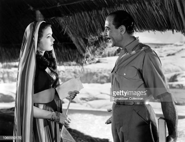 Actress Gene Tierney and Joseph Calleia in a scene from the movie Sundown