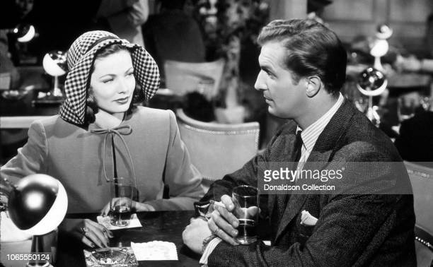 Actress Gene Tierney and Vincent Price in a scene from the movie Laura
