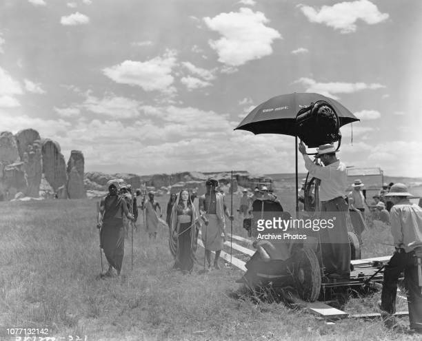 Actress Gene Tierney films a scene on location, for the movie 'Sundown', 1941.
