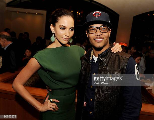 """Actress Genesis Rodriguez and actor/rapper T.I. Pose at the after party for the premiere of Universal Pictures' """"Identity Thief"""" at Napa Valley..."""