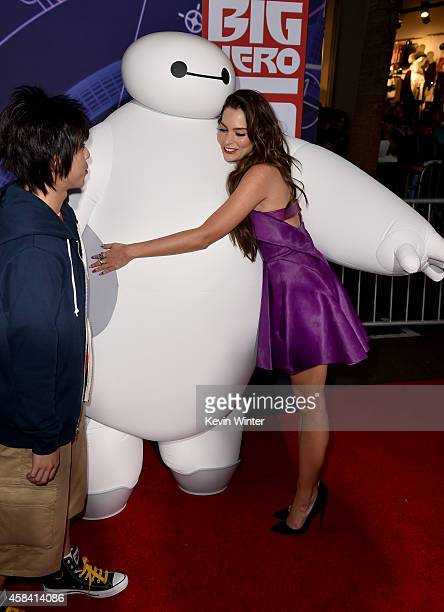 Actress Genesis Rodriguez with characters Hira and Baymax attend the premiere of Disney's Big Hero 6 at the El Capitan Theatre on November 4 2014 in...