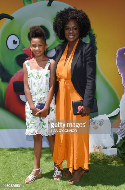 Actress Genesis Tennon and Viola Davis arrive for The Angry Birds Movie 2 World Premiere at the Regency Village Theatre in Westwood California on...
