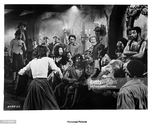 Actress Genevieve Bujold and Lee Pulford and actor James Earl Jones in a scene from the Universal Pictures movie Swashbuckler circa 1976