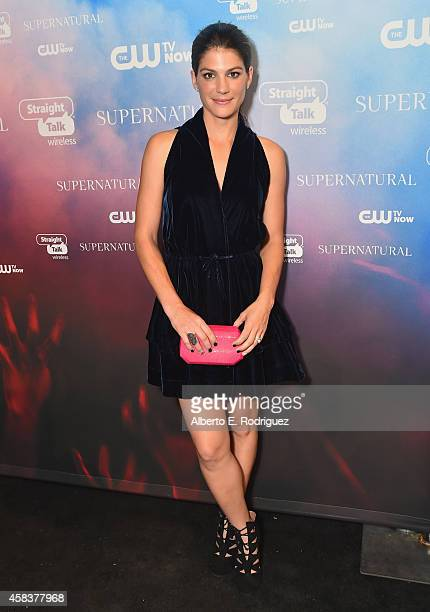 Actress Genevieve Padalecki attends the CW's Fan Party to Celebrate the 200th episode of 'Supernatural' on November 3 2014 in Los Angeles California